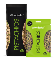 Black package of Wonderful Pistachios with shells and green package of Wonderful Pistachios with no shells